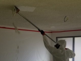 DURING: Popcorn Ceiling Asbestos Abatement. ATHR Technician in Personal Protection Gear. - Mesa, AZ