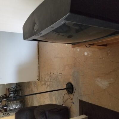 BEFORE: VCT Black Mastic Asbestos Abatement in Living Room - Scottsdale, AZ