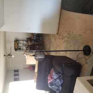 BEFORE:  VCT Black Mastic Asbestos Abatement in Living Room - Scottsdale, AZ