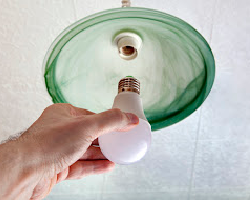 Fire Safety - Install light bulb in fixture - Arizona Total Home Restoration